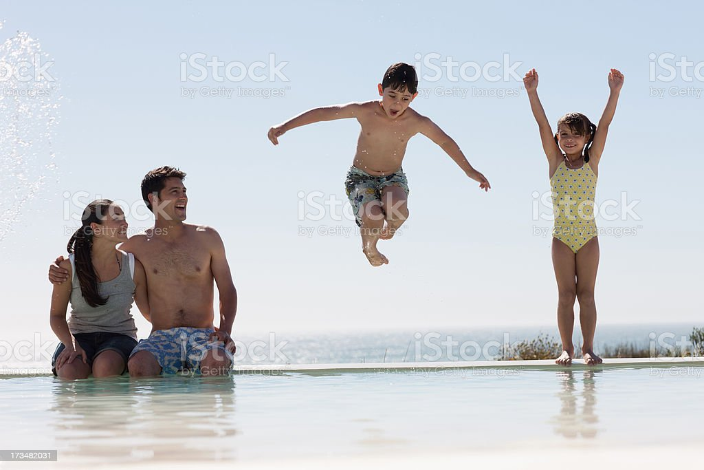 Family playing in swimming pool royalty-free stock photo