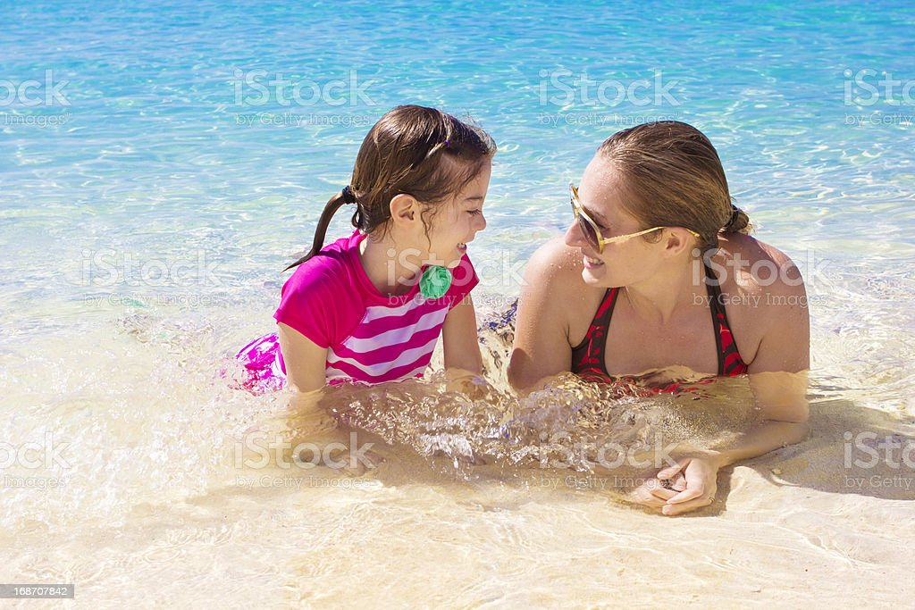 Family Playing in the beautiful Ocean royalty-free stock photo