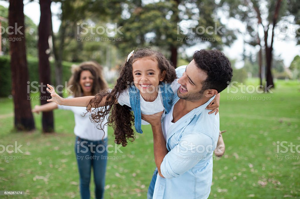 family playing in the park stock photo