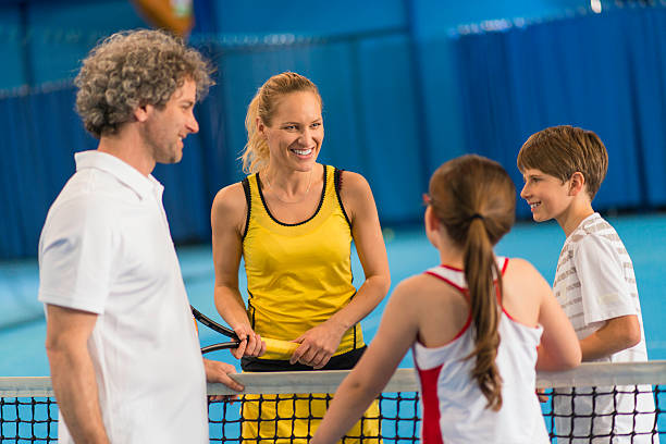 family playing indoors tennis - racket sport stock pictures, royalty-free photos & images