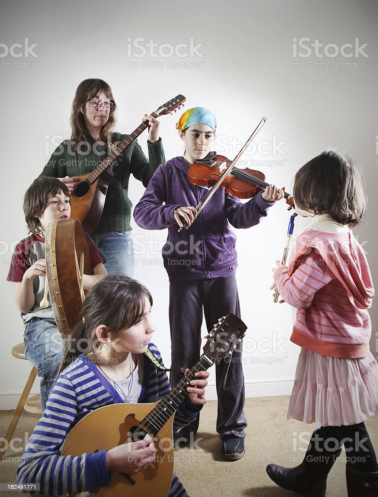 family playing irish music stock photo