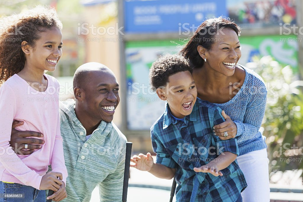 Family playing miniature golf stock photo