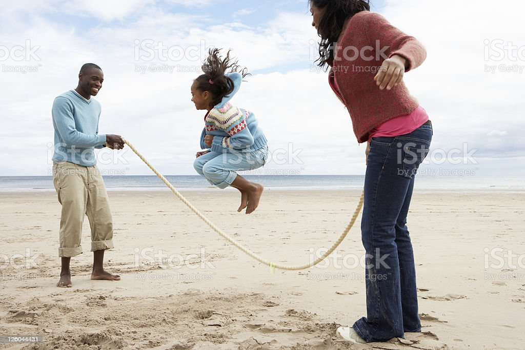 Family Playing On Beach stock photo