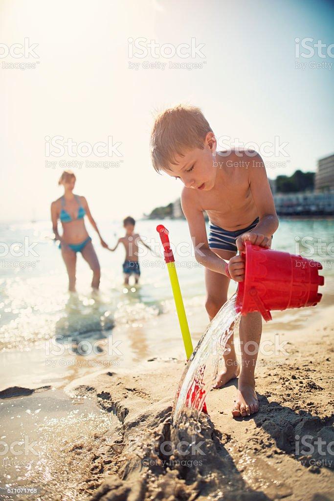 Family playing on majorca beach on sunny summer day stock photo
