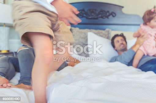 479612990 istock photo Family playing on the bed. 695685490