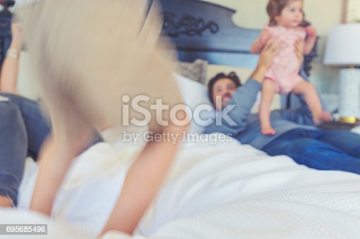 479612990 istock photo Family playing on the bed. 695685496