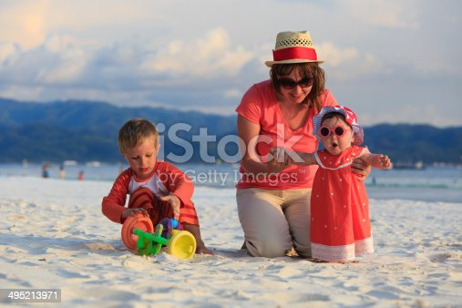 605742160 istock photo family playing on tropical beach 495213971