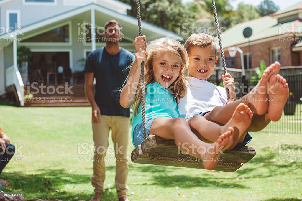family playing outdoors stock photo