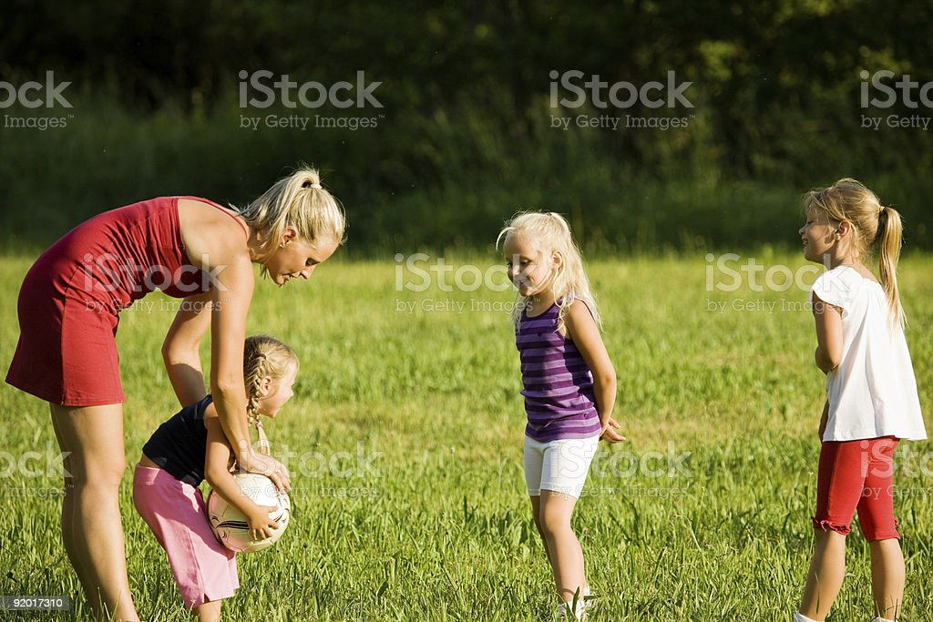Family playing soccer royalty-free stock photo