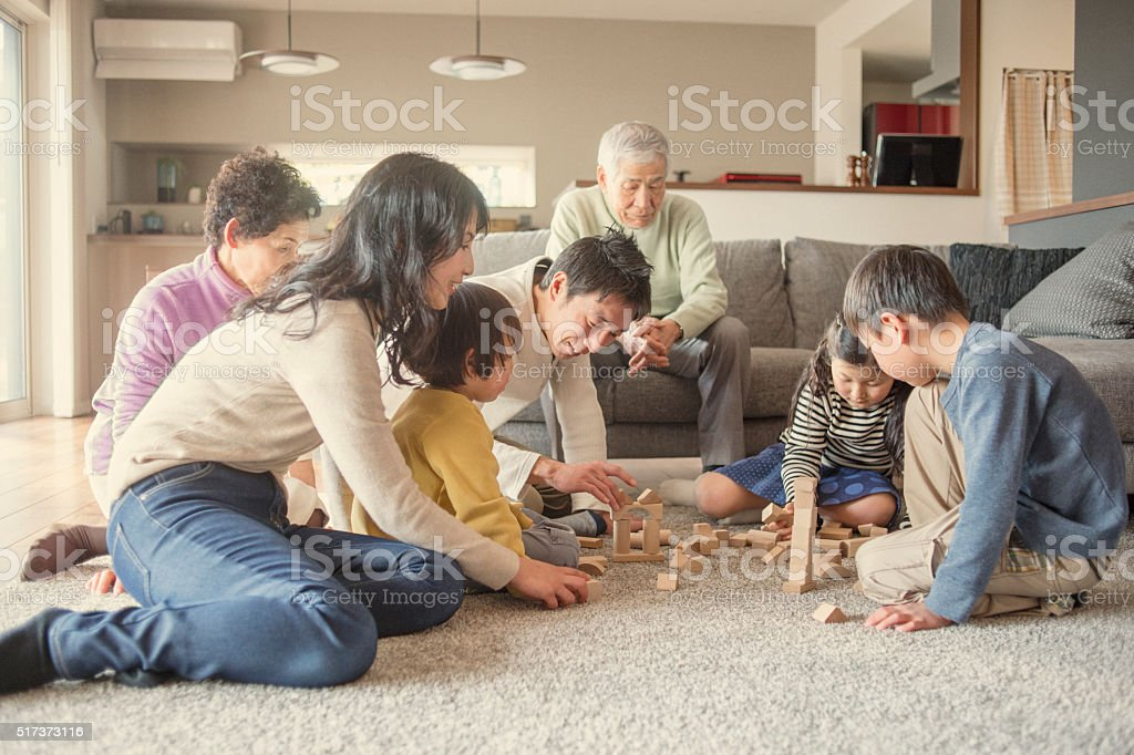 Family playing together at home stock photo