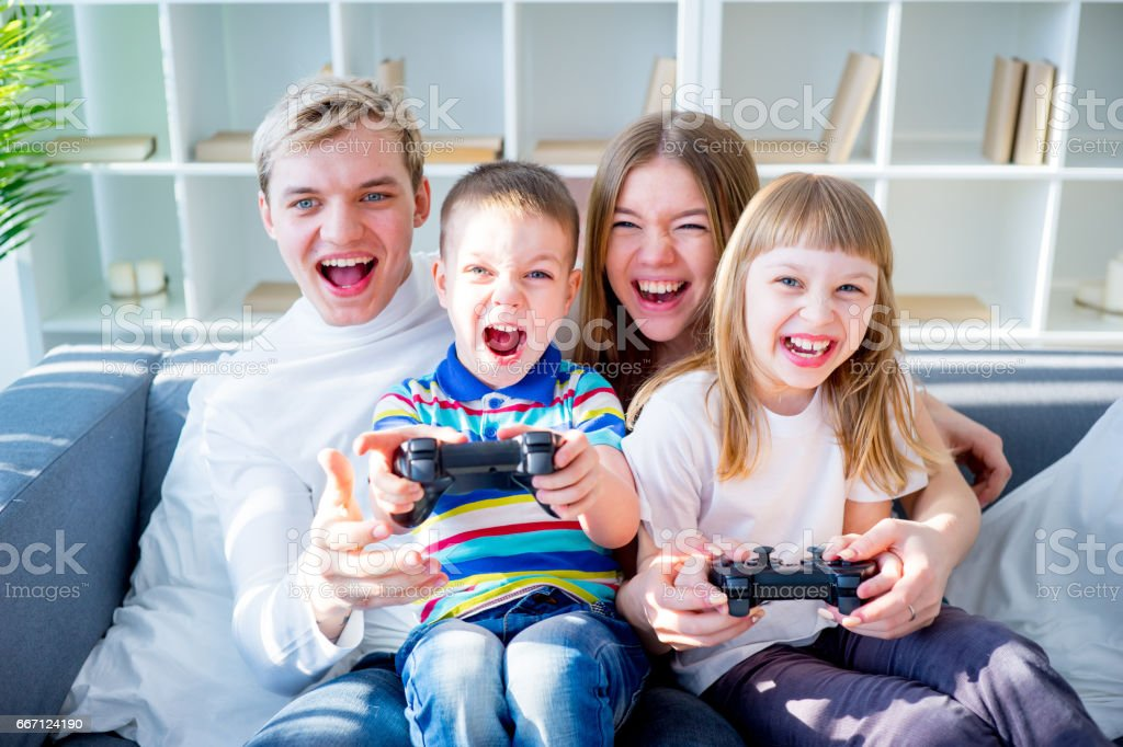Family playing video games stock photo
