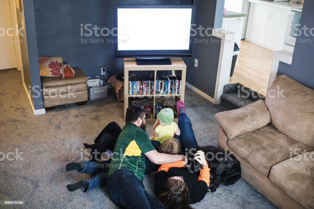 Family Playing While Watching Football Game stock photo