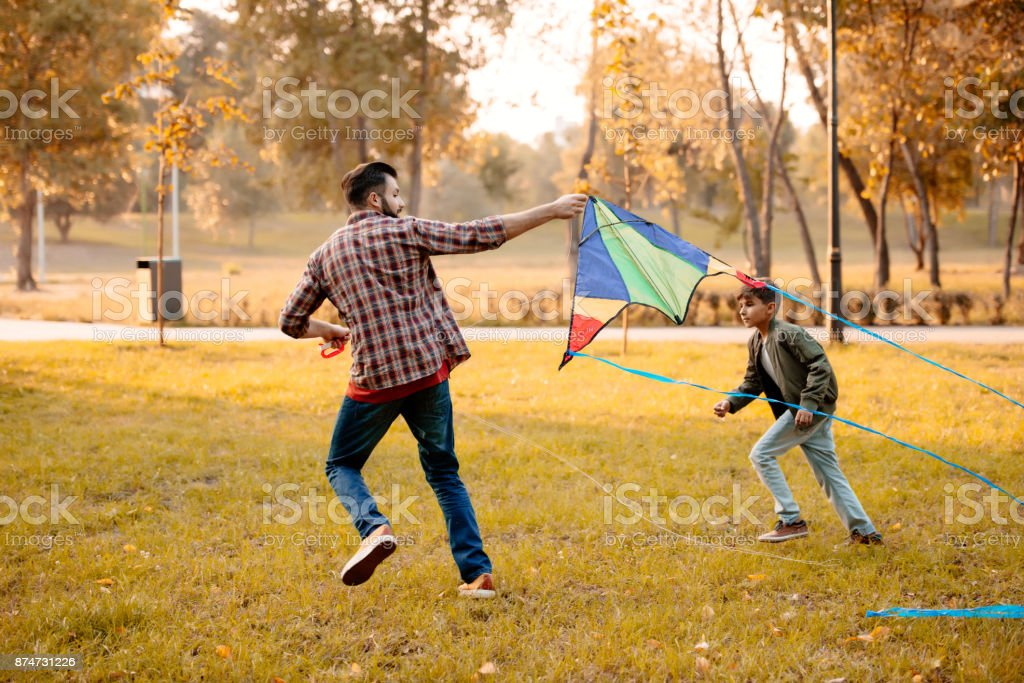 Family playing with kite stock photo