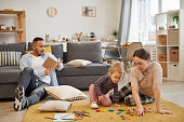 istock Family Playing with Little Girl at Home 1196980256