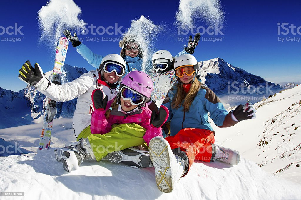Family playing with snow on ski stock photo