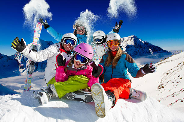 Family playing with snow on ski Ski family in italian Alps ski stock pictures, royalty-free photos & images