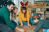 istock Family playing with the new Christmas gifts 1181484574