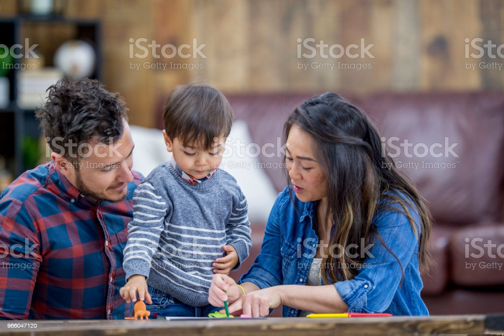 Family Playing With Toys - Royalty-free Adult Stock Photo