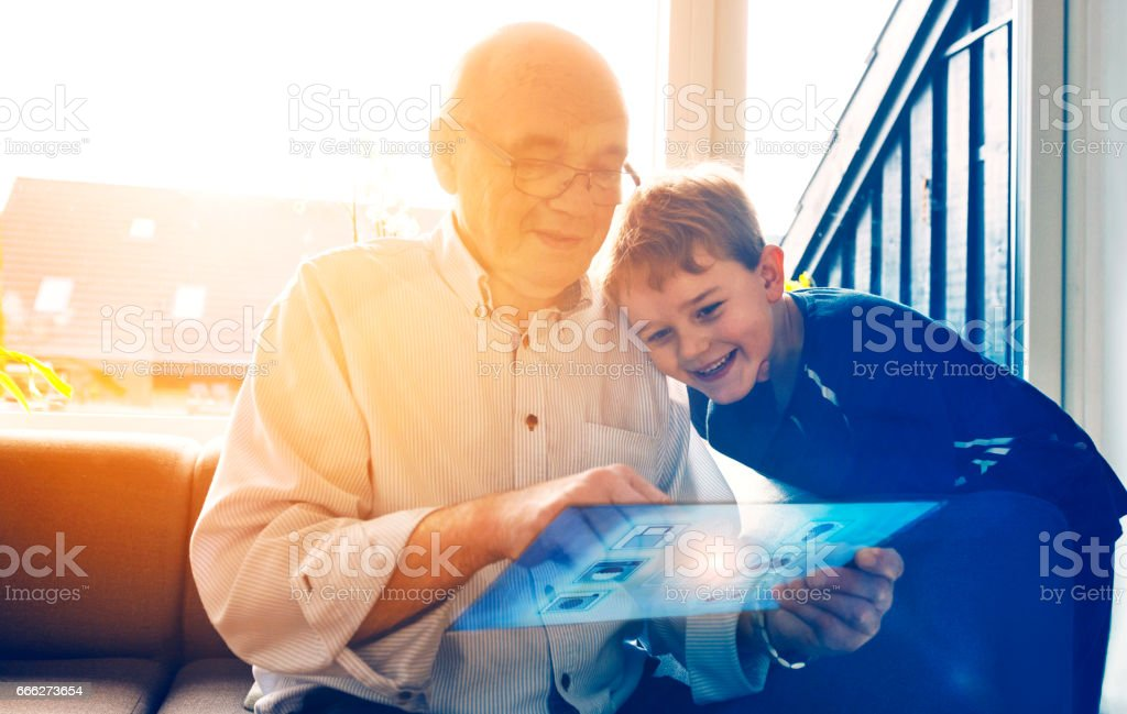 Family plays with digital tablet to connected to internet of things stock photo