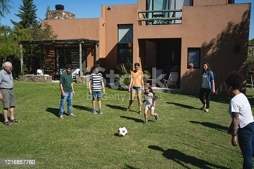 Big family playing around in their backyard
