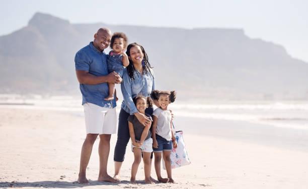 Familienportrait am Strand – Foto