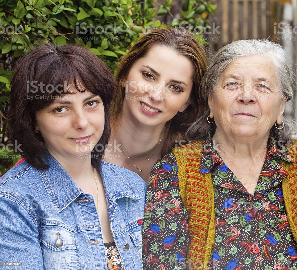 Family portrait - daughter granddaughter and grandmother royalty-free stock photo