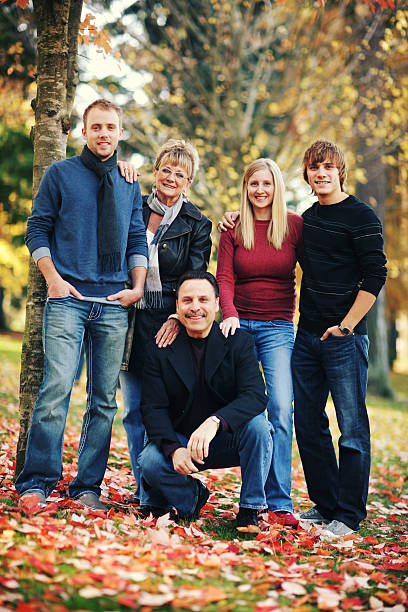 Family Portrait in Cool Fall Park stock photo