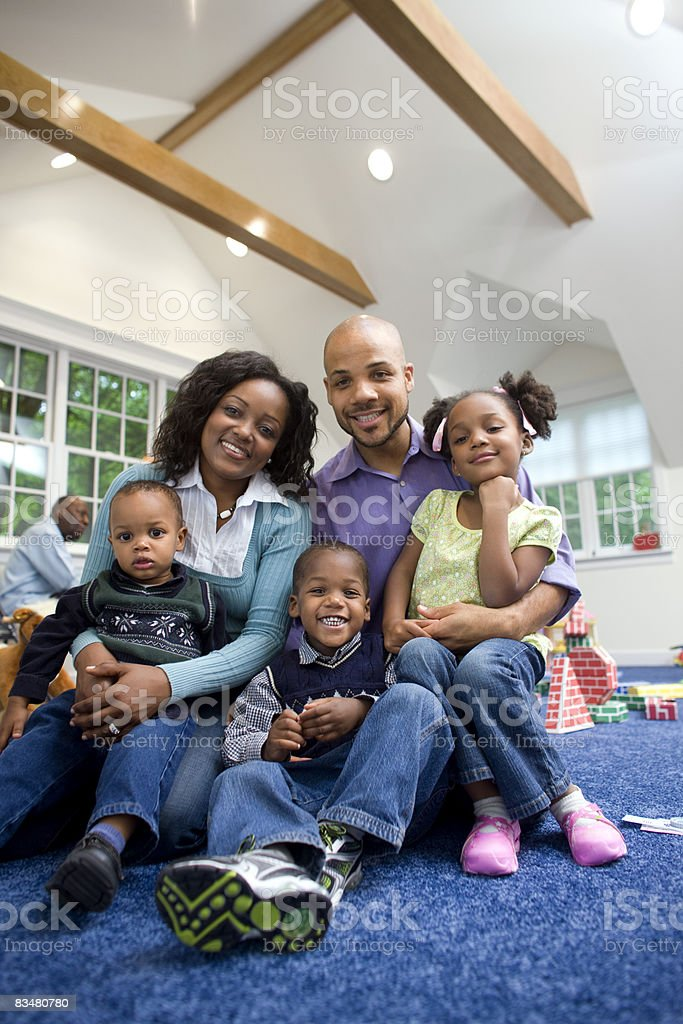 Family portrait in game room at home royalty free stockfoto