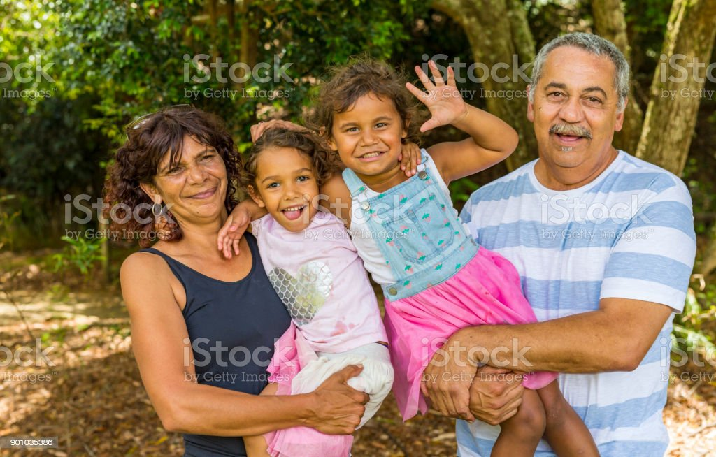 Family Portrait of an Australian Aboriginal Couple with Their Grandaughters stock photo
