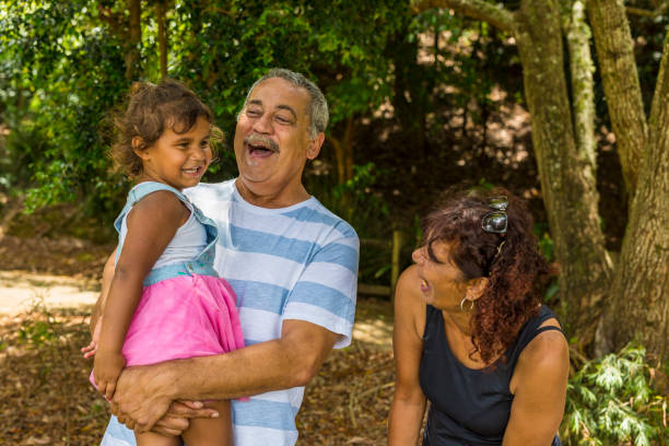 family portrait of an australian aboriginal couple with their grandaughter - day in the life series stock pictures, royalty-free photos & images