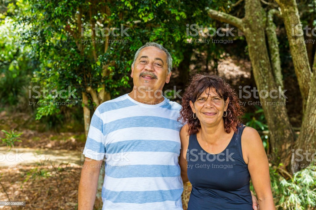 Family Portrait of an Australian Aboriginal Mother and Father Couple stock photo
