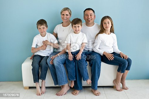 istock A family portrait of five in white T-shirts and blue jeans 157329076