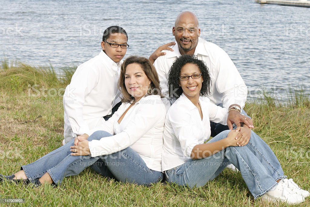 Family portrait of individuals of multiple ethnicities stock photo