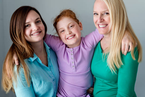 Family portrait of mother and daughters close-up. stock photo
