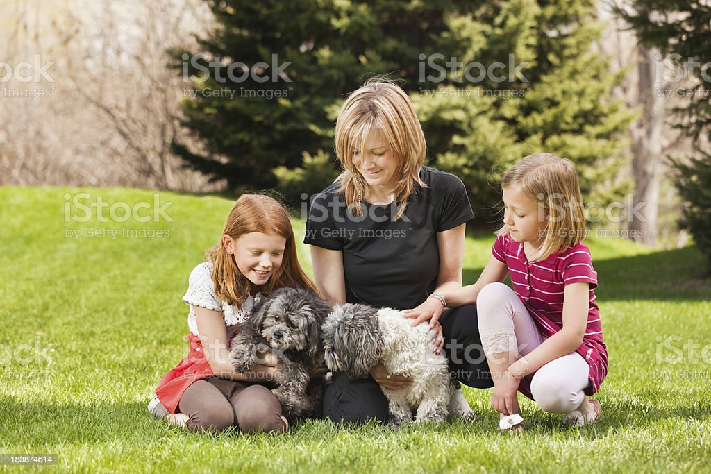 Family Portrait of Mother, Daughters and Dogs royalty-free stock photo