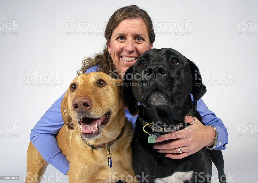 Family Portrait of Woman and her Dogs royalty-free stock photo
