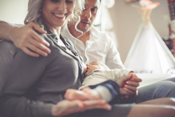 family portrait - woman breastfeeding husband stock photos and pictures