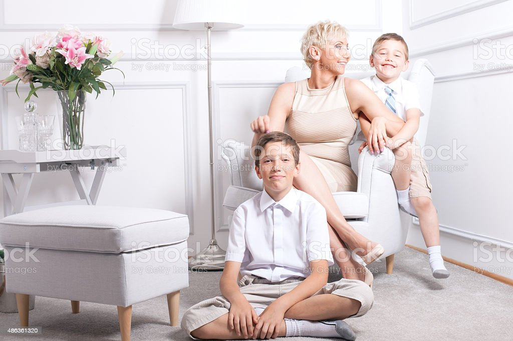 Family portrait, two brothers with mum. stock photo