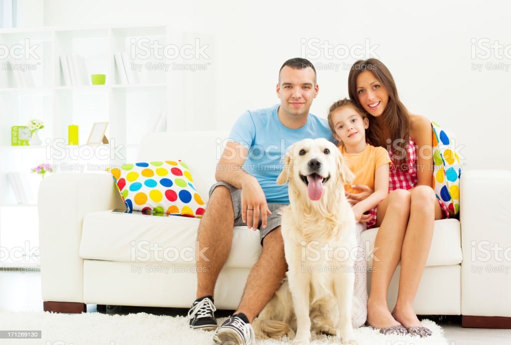Family portrait with dog relaxing at home royalty-free stock photo