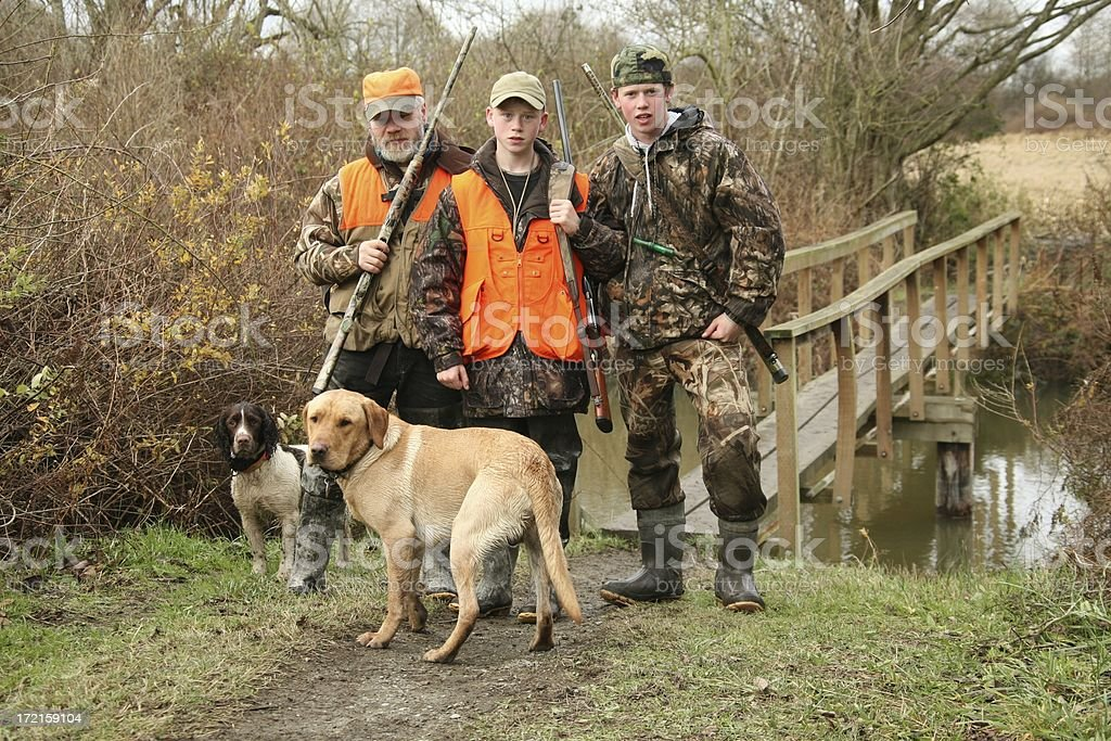 Family pose during hunting trip. stock photo