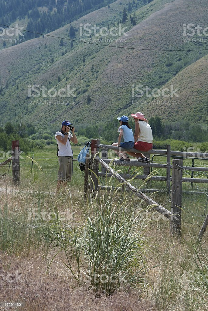 Family Poses for Photo on Old Wooden Fence stock photo