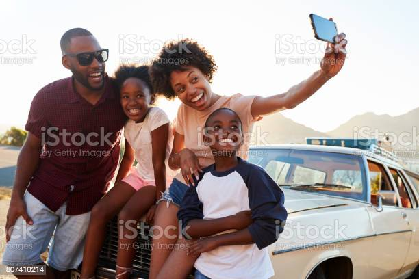 Family posing for selfie next to car packed for road trip picture id807410214?b=1&k=6&m=807410214&s=612x612&h=flusdl0og9pkj8mhl270uaoh7k2tapo0bqci6a qh9a=