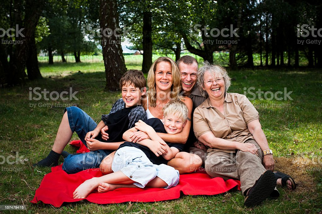 Family Posing In A Park royalty-free stock photo