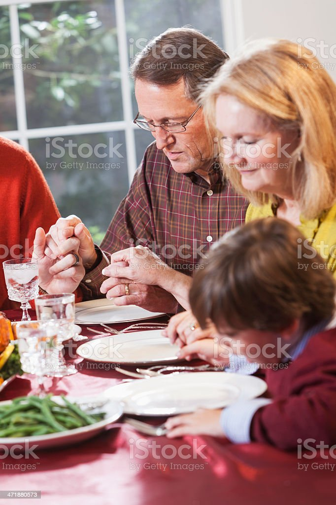 Family praying before meal royalty-free stock photo