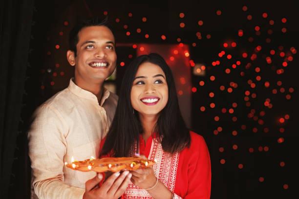 Family praying on Diwali stock photo