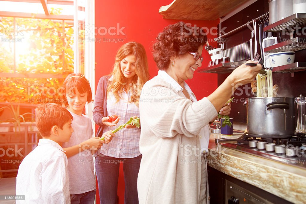 Family preparing a meal together stock photo
