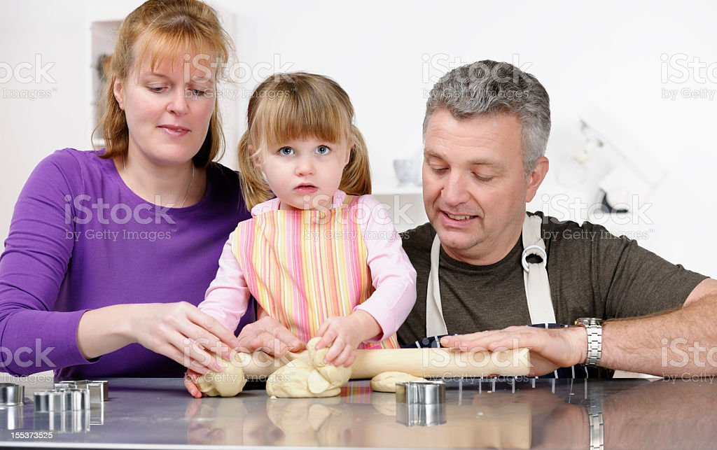 Family Preparing Dough Together royalty-free stock photo