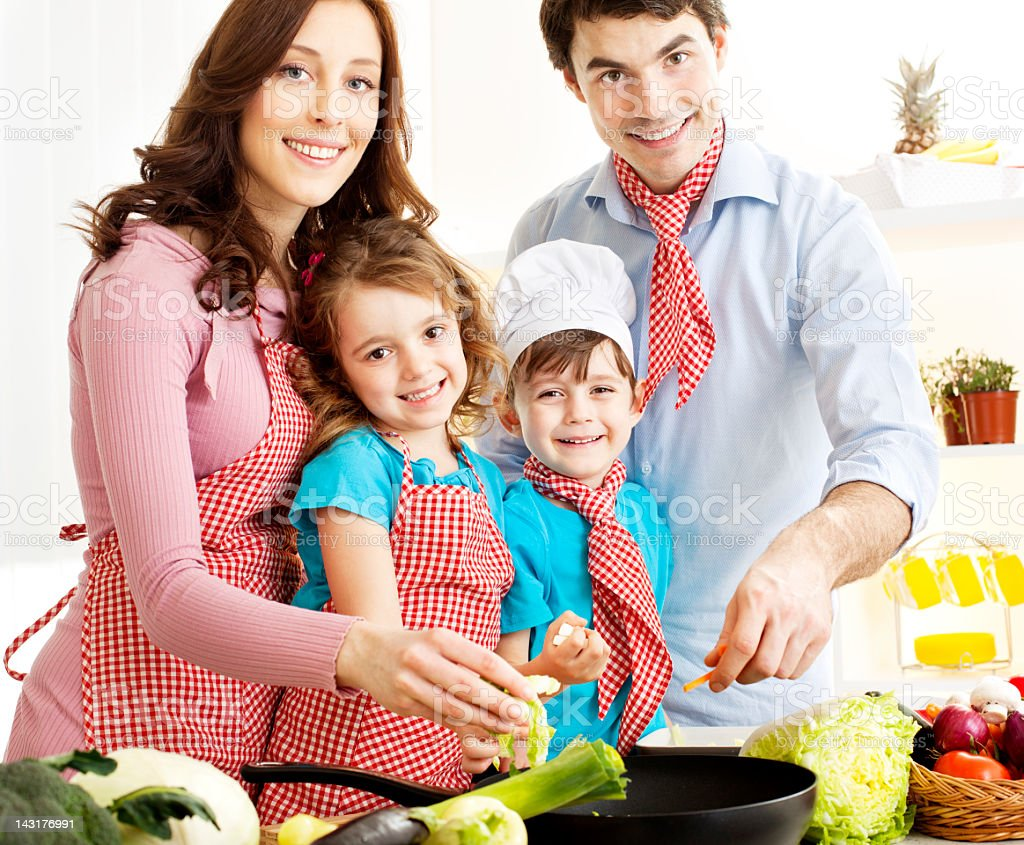 Family preparing food together. royalty-free stock photo