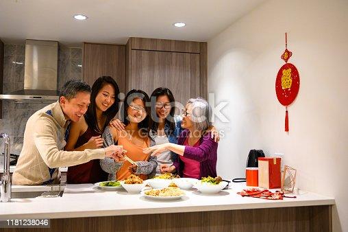 Chinese New Years celebrations. Family having dinner. Bonding over family traditions.