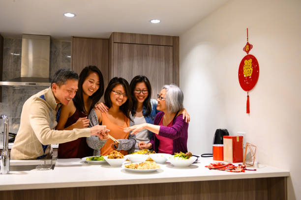 family preparing for chinese new years - chinese new year stock pictures, royalty-free photos & images